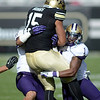 """Vincent Hobbs of CU is tackled by Sean  Parker of Washington.<br /> For more photos of the CU game, go to  <a href=""""http://www.dailycamera.com"""">http://www.dailycamera.com</a><br /> Cliff Grassmick / November 17, 2012"""