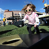 "Kaia Steele, 2,  plays bean bags with her dad during CU tailgating before the CU Washington football game on Saturday.<br /> For more photos of the CU game, go to  <a href=""http://www.dailycamera.com"">http://www.dailycamera.com</a><br /> Cliff Grassmick / November 17, 2012"