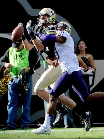 """Tyler McCulloch of CU gets the ball knocked away by Marcus Peters of Washington.<br /> For more photos of the CU game, go to  <a href=""""http://www.dailycamera.com"""">http://www.dailycamera.com</a><br /> Cliff Grassmick / November 17, 2012"""
