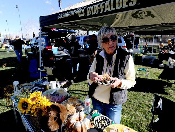 """Patti Phillips eats cake  during CU tailgating before the CU Washington football game on Saturday.<br /> For more photos of the CU game, go to  <a href=""""http://www.dailycamera.com"""">http://www.dailycamera.com</a><br /> Cliff Grassmick / November 17, 2012"""