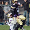 "CU QB Jordan Webb is sacked by Travis Feeney of Washington in the second half.<br /> For more photos of the CU game, go to  <a href=""http://www.dailycamera.com"">http://www.dailycamera.com</a><br /> Cliff Grassmick / November 17, 2012"