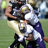 "Vincent Hobbs of CU is tackled by Gregory Ducre and Sean Parker (1), both of Washington.<br /> For more photos of the CU game, go to  <a href=""http://www.dailycamera.com"">http://www.dailycamera.com</a><br /> Cliff Grassmick / November 17, 2012"