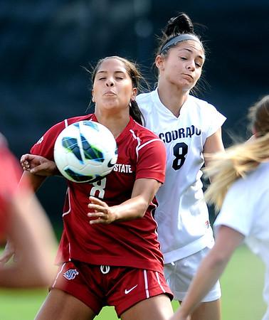"Micaela Castain of WSU and Quinn Krier of CU, struggle for control.<br /> For more photos of the game, go to  <a href=""http://www.dailycamera.com"">http://www.dailycamera.com</a>.<br /> Cliff Grassmick  / September 30, 2012"