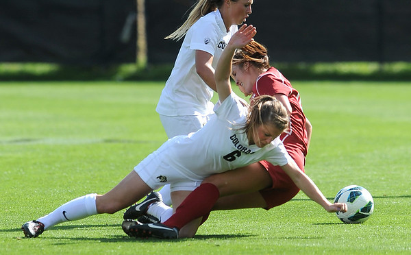 "Hayley Hughes (6) of CU, and Beau Bremer of WSU, battle to the ground.<br /> For more photos of the game, go to  <a href=""http://www.dailycamera.com"">http://www.dailycamera.com</a>.<br /> Cliff Grassmick  / September 30, 2012"