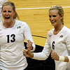 "University of Colorado's Jessica Aschenbrenner, left, and Kerra Schroeder cheer after scoring a point during a volleyball game against the University of Washington on Saturday, Nov. 19, at the Coors Event Center on the CU campus in Boulder. For more photos of the game go to  <a href=""http://www.dailycamera.com"">http://www.dailycamera.com</a><br /> Jeremy Papasso/ Camera"