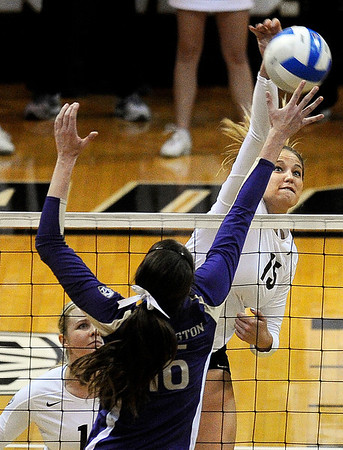 "University of Colorado's Nikki Lindow goes for a kill over Washington's Krista Vansant  during a volleyball game against the University of Washington on Saturday, Nov. 19, at the Coors Event Center on the CU campus in Boulder. For more photos of the game go to  <a href=""http://www.dailycamera.com"">http://www.dailycamera.com</a><br /> Jeremy Papasso/ Camera"