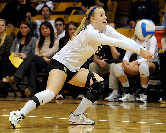"University of Colorado's Emily Alexis saves the ball during a volleyball game against the University of Washington on Saturday, Nov. 19, at the Coors Event Center on the CU campus in Boulder. For more photos of the game go to  <a href=""http://www.dailycamera.com"">http://www.dailycamera.com</a><br /> Jeremy Papasso/ Camera"