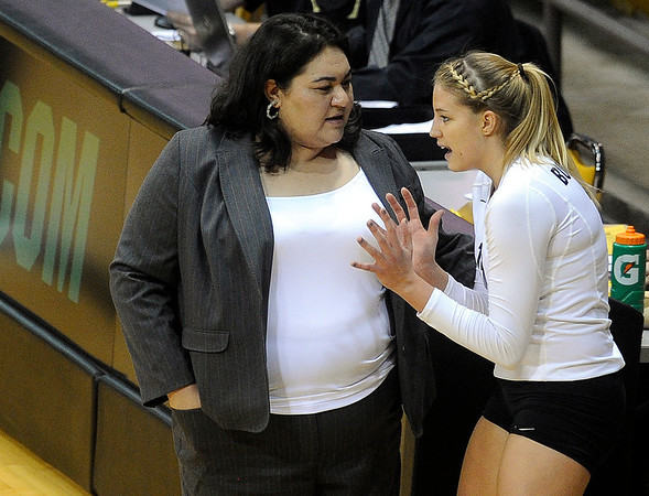"""University of Colorado Head Coach Liz Kritza talks with Nikki Lindow during a timeout during a volleyball game against the University of Washington on Saturday, Nov. 19, at the Coors Event Center on the CU campus in Boulder. For more photos of the game go to  <a href=""""http://www.dailycamera.com"""">http://www.dailycamera.com</a><br /> Jeremy Papasso/ Camera"""