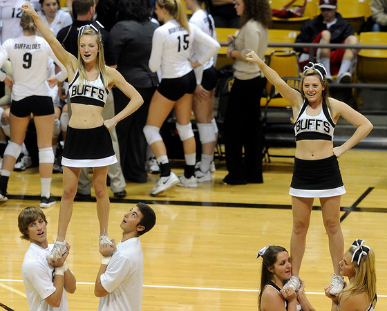 "University of Colorado cheerleaders get the crowd pumped up during a volleyball game against the University of Washington on Saturday, Nov. 19, at the Coors Event Center on the CU campus in Boulder. For more photos of the game go to  <a href=""http://www.dailycamera.com"">http://www.dailycamera.com</a><br /> Jeremy Papasso/ Camera"