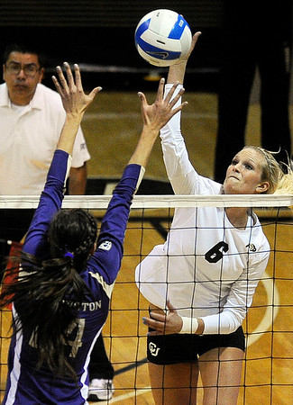"University of Colorado's Kerra Schroeder goes for a kill over Washington's Kylin Munoz during a volleyball game against the University of Washington on Saturday, Nov. 19, at the Coors Event Center on the CU campus in Boulder. For more photos of the game go to  <a href=""http://www.dailycamera.com"">http://www.dailycamera.com</a><br /> Jeremy Papasso/ Camera"
