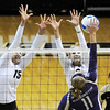 "University of Colorado's Nikki Lindow, left, and Kerra Schroeder try to block a kill from Washington's Gabbi Parker during a volleyball game against the University of Washington on Saturday, Nov. 19, at the Coors Event Center on the CU campus in Boulder. For more photos of the game go to  <a href=""http://www.dailycamera.com"">http://www.dailycamera.com</a><br /> Jeremy Papasso/ Camera"
