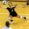 "University of Colorado's Megan Beckwith saves the ball during a volleyball game against the University of Washington on Saturday, Nov. 19, at the Coors Event Center on the CU campus in Boulder. For more photos of the game go to  <a href=""http://www.dailycamera.com"">http://www.dailycamera.com</a><br /> Jeremy Papasso/ Camera"