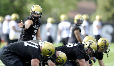 "University of Colorado quarterback Cody Hawkins (7), runs a drill with teammates at the first practice of the season at CU's practice field on Friday, Aug. 7, 2009. Watch the video at  <a href=""http://www.dailycamera.com"">http://www.dailycamera.com</a> (Photo by Mara Auster)."
