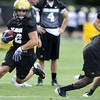 "University of Colorado Wide Receiver Ryan Maxwell (12), left, grabs a ball passed by a Tailback Darrell Scott (2), far right, during drills at the first practice of the season at CU's practice field on Friday, Aug. 7, 2009. Watch the video at  <a href=""http://www.dailycamera.com"">http://www.dailycamera.com</a> (Photo by Mara Auster)."