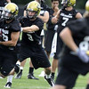 "University of Colorado Quarterback Tyler Hansen (9), middle, hands the ball off to Wide Receiver Jason Espinoza (15), left, during drills at the first practice of the season at CU's practice field on Friday, Aug. 7, 2009. Watch the video at  <a href=""http://www.dailycamera.com"">http://www.dailycamera.com</a> (Photo by Mara Auster)."