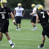 "University of Colorado quarterback Tyler Hansen (9), left, runs a drill with quarterback Cody Hawkins (7), right, at the first practice of the season at CU's practice field on Friday, Aug. 7, 2009. Watch the video at  <a href=""http://www.dailycamera.com"">http://www.dailycamera.com</a> (Photo by Mara Auster)."