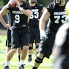 "University of Colorado quarterback Tyler Hansen (9), throws the ball during the first practice of the season, while Ryan Miller (73) and the rest of the team run drills at CU's practice field on Friday, Aug. 7, 2009. Watch the video at  <a href=""http://www.dailycamera.com"">http://www.dailycamera.com</a> (Photo by Mara Auster)."