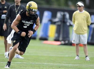 "University of Colorado quarterback Cody Hawkins runs a drill during the first practice of the season at CU's practice field on Friday, Aug. 7, 2009. Watch the video at  <a href=""http://www.dailycamera.com"">http://www.dailycamera.com</a> (Photo by Mara Auster)."