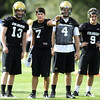 "University of Colorado quarterback Cody Hawkins (7), talks with fellow quarterbacks Jerry Slota (13), Clark Evans (4) and Tyler Hansen (9) at the first practice of the season at CU's practice field on Friday, Aug. 7, 2009. Watch the video at  <a href=""http://www.dailycamera.com"">http://www.dailycamera.com</a> (Photo by Mara Auster)."