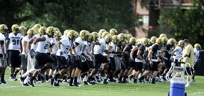 "University of Colorado Buffaloes warm up during the first practice of the season at CU's practice field on Friday, Aug. 7, 2009. Watch the video at  <a href=""http://www.dailycamera.com"">http://www.dailycamera.com</a> (Photo by Mara Auster)."