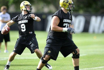 "University of Colorado quarterback Tyler Hansen (9), left, throws the ball during drills with offensive lineman Matthew Bahr (71), right, at the first practice of the season at CU's practice field on Friday, Aug. 7, 2009. Watch the video at  <a href=""http://www.dailycamera.com"">http://www.dailycamera.com</a> (Photo by Mara Auster)."