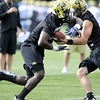 "University of Colorado Tailback Darrell Scott (2), left, grabs a ball handed to him by a teammate during the first practice of the season at CU's practice field on Friday, Aug. 7, 2009. Watch the video at  <a href=""http://www.dailycamera.com"">http://www.dailycamera.com</a> (Photo by Mara Auster)."