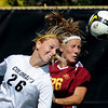 Mel Hicks, left, of CU, and Amanda Woelfel of ISU, both meet the ball during the first have of the game in Boulder on Sunday. CU shut out Iowa State 1-0.<br /> Cliff Grassmick / September 27, 2009