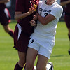 Emily Hejlik, left, of ISU, collides with Nikki Marshall of CU on Sunday.<br /> Cliff Grassmick / September 27, 2009