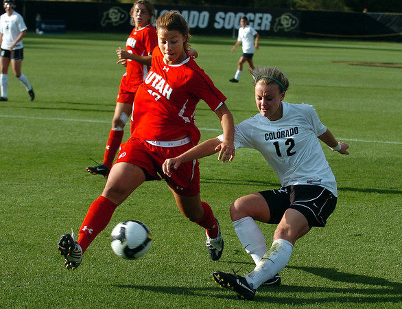 Kelly Butler of CU takes a shot on goal against Stephanie Lemeza of Utah.<br /> Cliff Grassmick / September 11, 2009
