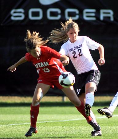 Lauren Hair, left, of Utah and Caroline Danneberg of CU try to control the ball.<br /> <br /> Cliff Grassmick / September 11, 2009