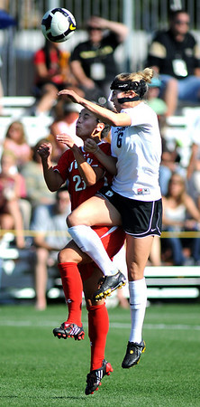 Amy Barczuk, right, of CU and Kelly Isleib of Utah battle on the header.<br /> <br /> Cliff Grassmick / September 11, 2009