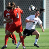 Kelly Menachof, right, of CU, gets the ball from Lauren Porter of Utah.<br /> <br /> Cliff Grassmick / September 11, 2009