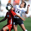 Amanda Foulk, right, of CU, and Lauren Porter of Utah collide.<br /> <br /> Cliff Grassmick / September 11, 2009
