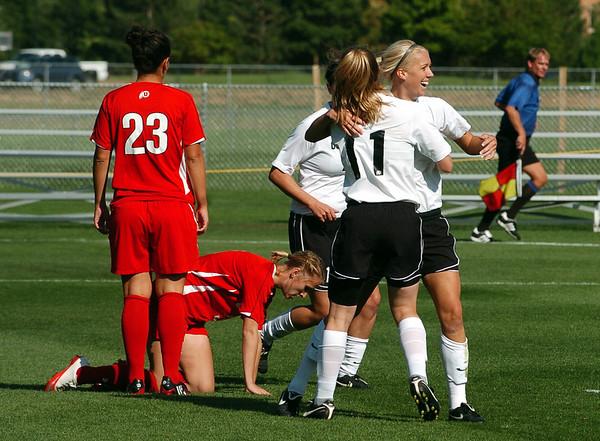 Erin Bricker (11) of CU hugs Kelly Ross after Ross scores CU's first goal Utah.<br /> <br /> Cliff Grassmick / September 11, 2009