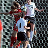 Taryn Vitacca (14) of CU, battles Utah at the goal on Friday.<br /> <br /> Cliff Grassmick / September 11, 2009
