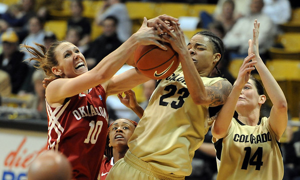 "Carlee Roethlisberger, left, of OU, and Chucky Jeffery of CU, battle for the rebound.<br /> For more photos of the game, go to  <a href=""http://www.dailycamera.com"">http://www.dailycamera.com</a><br /> Cliff Grassmick / February 23, 2011"