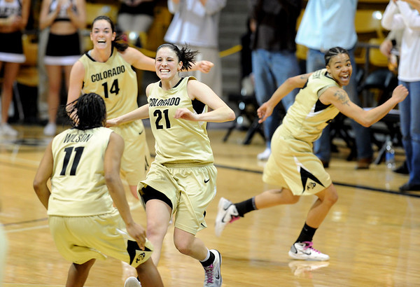 """Chelsea Dale (21) celebrates with her Colorado teammates after the upset win over 16th-ranked Oklahoma.<br /> For more photos of the game, go to  <a href=""""http://www.dailycamera.com"""">http://www.dailycamera.com</a><br /> Cliff Grassmick / February 23, 2011"""