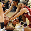 Chucky Jeffery, bottom, of Colorado, holds on to the ball as her teammate Brittany Wilson, top, and Morgan Hook of Oklahoma reach in  for the ball during  the first half of the February 23, 2011 game in Boulder.<br /> Cliff Grassmick / February 23, 2011