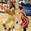"Brittany Spears of CU drives around Morgan Hook of OU.<br /> For more photos of the game, go to  <a href=""http://www.dailycamera.com"">http://www.dailycamera.com</a><br /> Cliff Grassmick / February 23, 2011"
