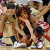 "Meaghan Malcolm-Peck of CU and Danielle Robinson of Oklahoma fight for the ball.<br /> For more photos of the game, go to  <a href=""http://www.dailycamera.com"">http://www.dailycamera.com</a><br /> Cliff Grassmick / February 23, 2011"