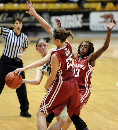 """Chelsea Dale of CU, tries to get a pass around Whitney Hand of OU.<br /> For more photos of the game, go to  <a href=""""http://www.dailycamera.com"""">http://www.dailycamera.com</a><br /> Cliff Grassmick / February 23, 2011"""