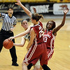 "Chelsea Dale of CU, tries to get a pass around Whitney Hand of OU.<br /> For more photos of the game, go to  <a href=""http://www.dailycamera.com"">http://www.dailycamera.com</a><br /> Cliff Grassmick / February 23, 2011"