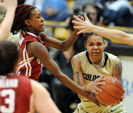 "Chucky Jeffery, right, of Colorado, tries to keep the ball from Danielle Robinson of Oklahoma.<br /> For more photos of the game, go to  <a href=""http://www.dailycamera.com"">http://www.dailycamera.com</a><br /> Cliff Grassmick / February 23, 2011"