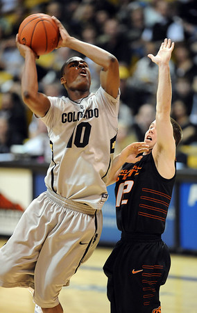 """Alec Burks of CU shoots over Keiton Page of Oklahoma State.<br /> For more photos of the game, go to  <a href=""""http://www.dailycamera.com"""">http://www.dailycamera.com</a>.<br /> Cliff Grassmick / January 15, 2011"""