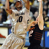 "Alec Burks of CU shoots over Keiton Page of Oklahoma State.<br /> For more photos of the game, go to  <a href=""http://www.dailycamera.com"">http://www.dailycamera.com</a>.<br /> Cliff Grassmick / January 15, 2011"