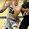 "Levi Knutson of CU goes to the basket on Markel Brown of Oklahoma State.<br /> For more photos of the game, go to  <a href=""http://www.dailycamera.com"">http://www.dailycamera.com</a>.<br /> Cliff Grassmick / January 15, 2011"