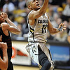 "Cory Higgins of CU drives to the basket against Oklahoma State on Saturday.<br /> For more photos of the game, go to  <a href=""http://www.dailycamera.com"">http://www.dailycamera.com</a>.<br /> Cliff Grassmick / January 15, 2011"