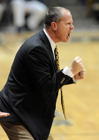 """Tad Boyle of CU  encourages the Buffs against Oklahoma State.<br /> For more photos of the game, go to  <a href=""""http://www.dailycamera.com"""">http://www.dailycamera.com</a>.<br /> Cliff Grassmick / January 15, 2011"""