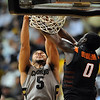 "Marcus Relphorde of CU gets the dunk in over Jean-Paul Olukemi of OSU.<br /> For more photos of the game, go to  <a href=""http://www.dailycamera.com"">http://www.dailycamera.com</a>.<br /> Cliff Grassmick / January 15, 2011"