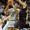 "Andre Roberson of CU shoots over Marshall Moses of Oklahoma State.<br /> For more photos of the game, go to  <a href=""http://www.dailycamera.com"">http://www.dailycamera.com</a>.<br /> Cliff Grassmick / January 15, 2011"